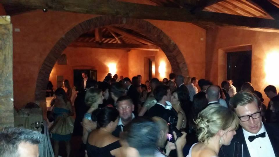 Castello di Meleto, the wedding partyinside the scuderia.