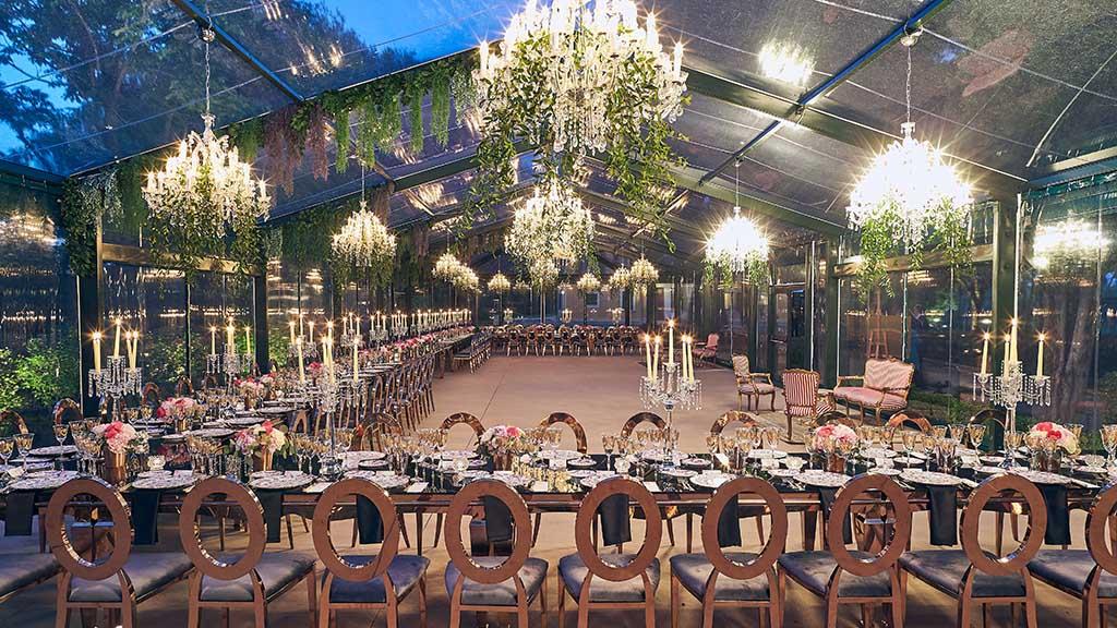 The wonderful orangerie hall of the Villa ready for a wedding reception dinner